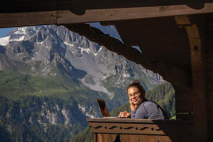 Student journaling in the Alps