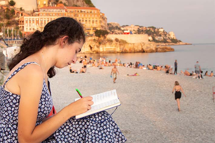 Student journaling in Nice