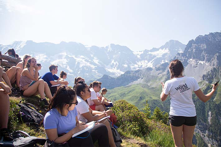 Students and Teacher looking out over the Alps