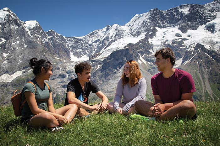 Students overlooking the Alps