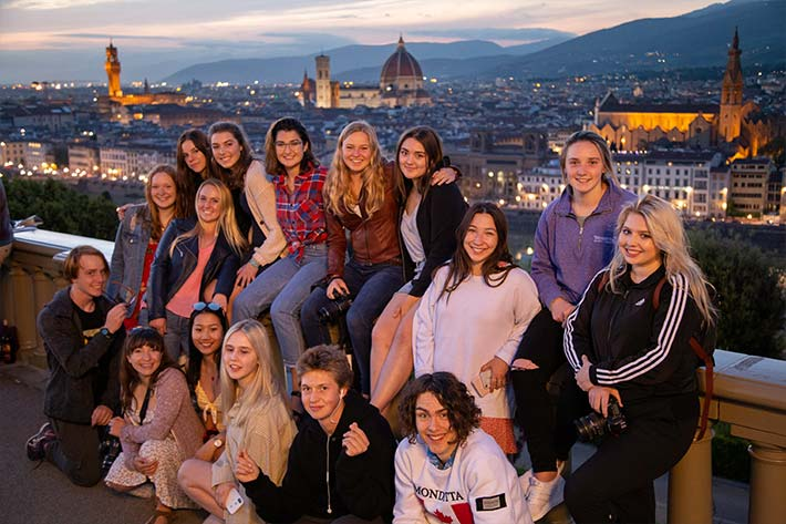 Students posing over Florence Skyline