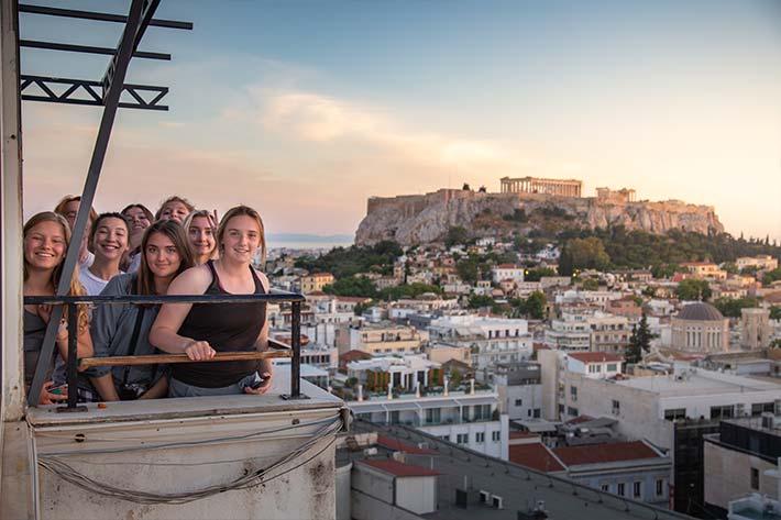 Students overlooking Athens skyline