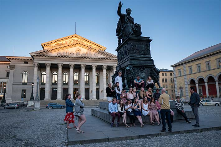 Students in front of Statue