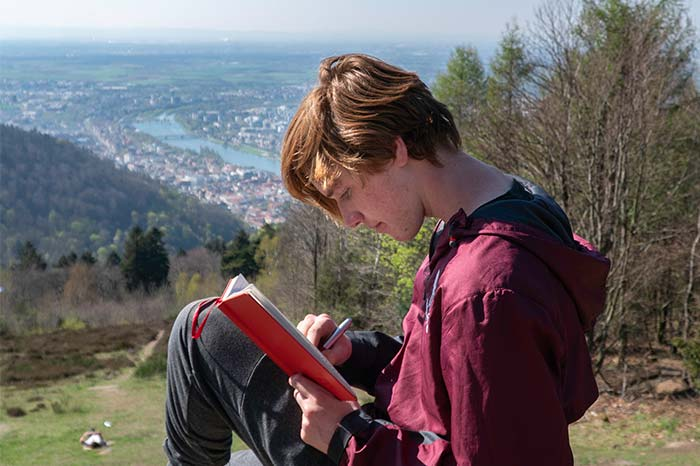Student studying while overlooking the Rhine