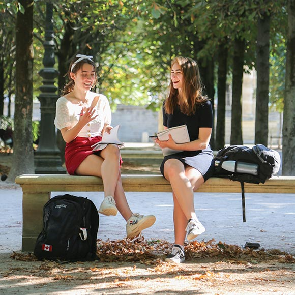 students studying on bench