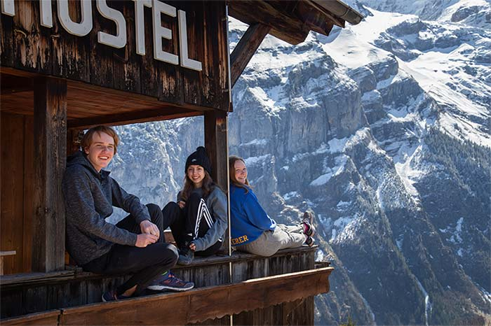 Students relaxing at Hostel in the Swiss Alps
