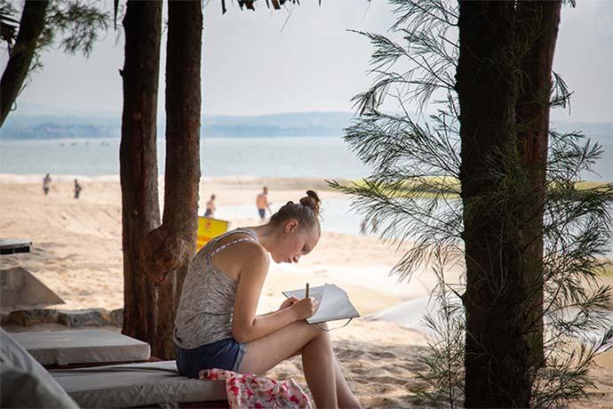Student studying on the beaches of Mui Ne
