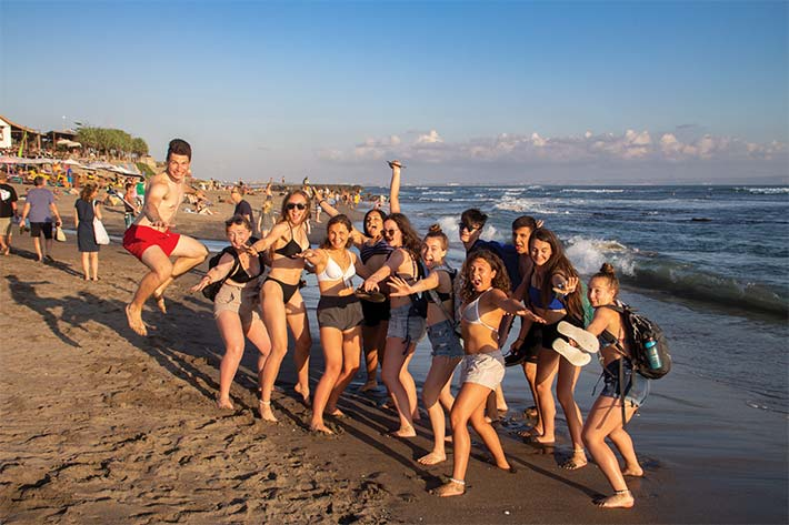 Students posing on the beach