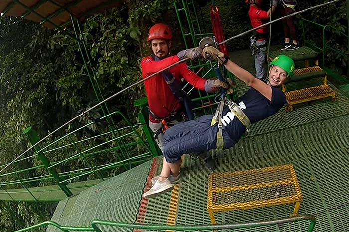 Student ziplining in the jungle
