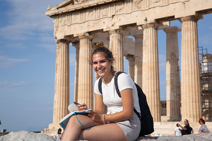 Student in front of the Parthenon